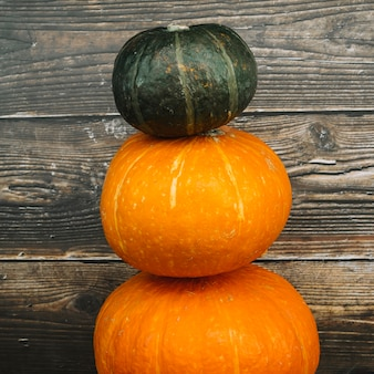 Squashes near wooden wall
