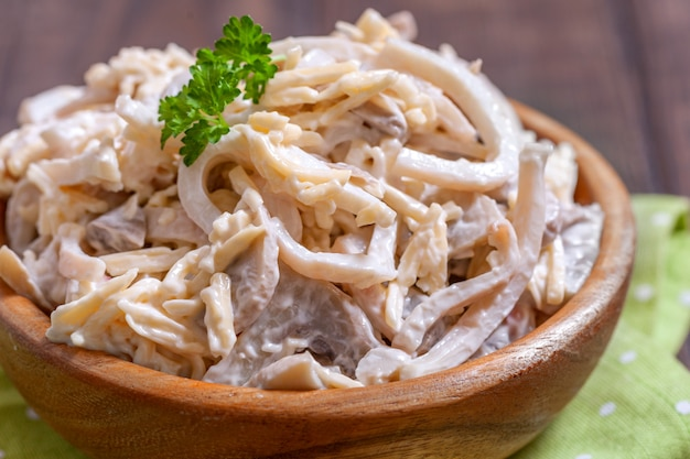 Squid cheese salad with mushroom and mayonnaise sauce