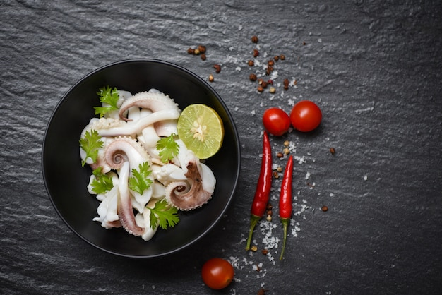 Squid salad bowl with lemon herbs and spices