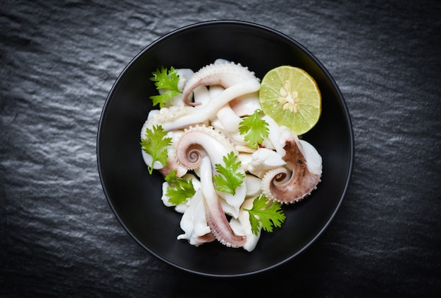 Squid salad bowl with lime herbs and spices tentacles octopus cooked appetizer food