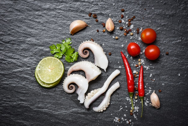 Squid salad with lemon herbs and spices on dark background