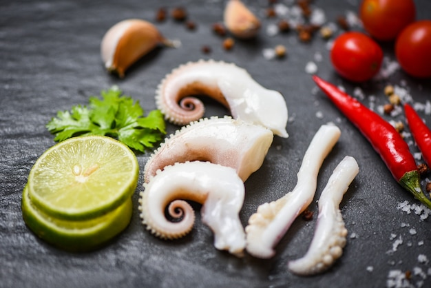 Squid salad with lemon herbs and spices tentacles octopus cooked appetizer food
