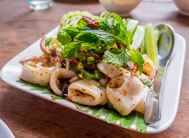 Squid spicy salad with herbs