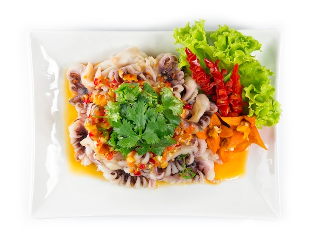 Squid tentacles serving on top with seafood spicy sauce