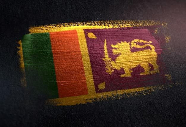 Sri lanka  flag made of metallic brush paint on grunge dark wall