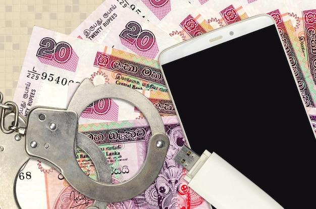 Шри-ланкийские рупии и смартфон с полицейскими наручниками