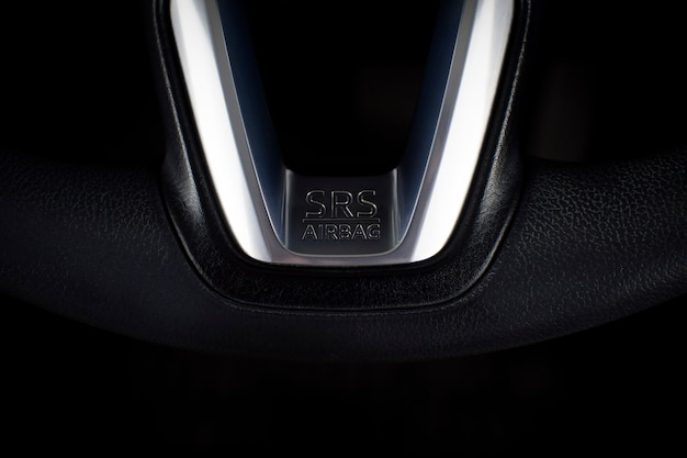 Srs airbag icon on steering wheel in a luxury car.