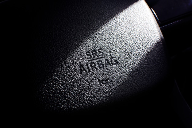 Srs airbag symbol on steering wheel in a car.