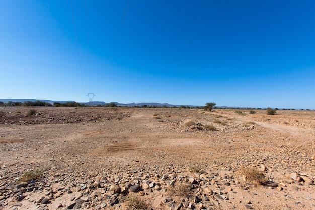 Ssaザグ、モロッコの岩が多い砂漠の風景