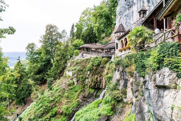 St. beatus cave and waterfalls above thunersee, sundlauenen, switzerland.