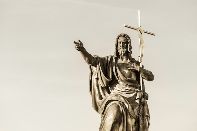 St. john the baptist statue on charles bridge. prague, czech republic