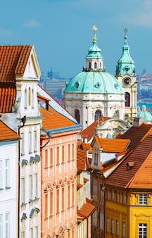 St. nicolas church and and roofs of prague