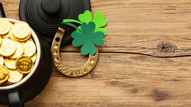 St patrick items on wooden table top view