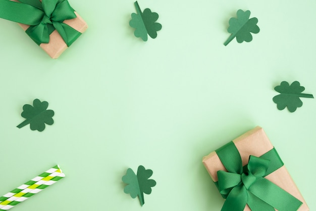 St patrick's day background. gift boxes, clover and festive decor