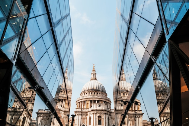 St. paul's cathedral church ireflected in glass walls of one new change in london.