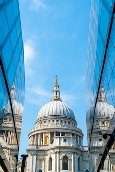 St. paul's cathedral church reflected in glass walls of one new change in london.
