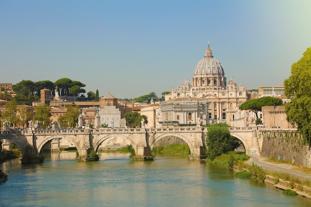 St. peter basilica over bridge and tiber river in rome, italy