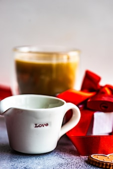 St. valentine day concept with coffee cup and cookies