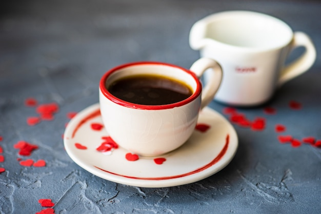 St. valentine day concept with coffee cup and hearts