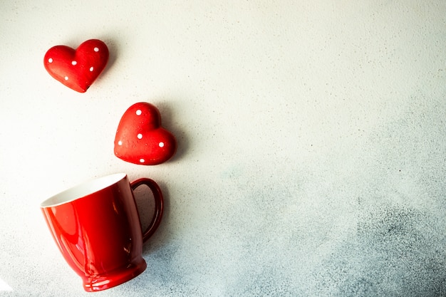 St. valentine day concept with a mug and hearts