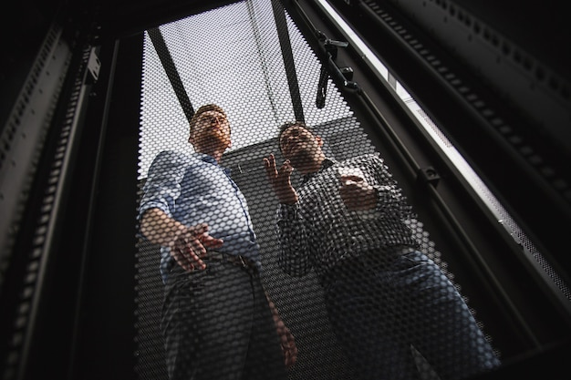 Stable connection. low angle of charming it technicians communicating while standing
