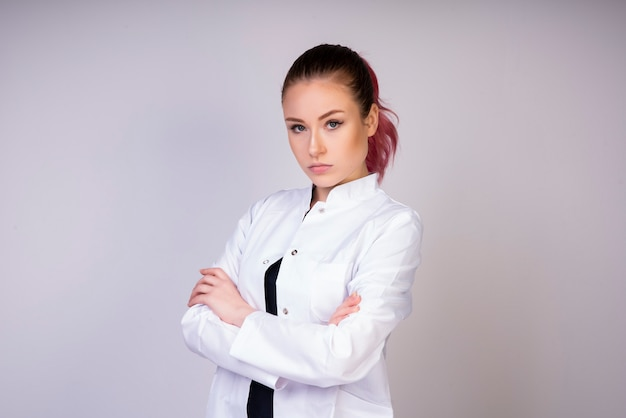 Stable girl in white doctor uniform