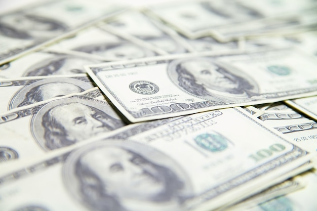 Stack of 100 us dollars isolated over white background.