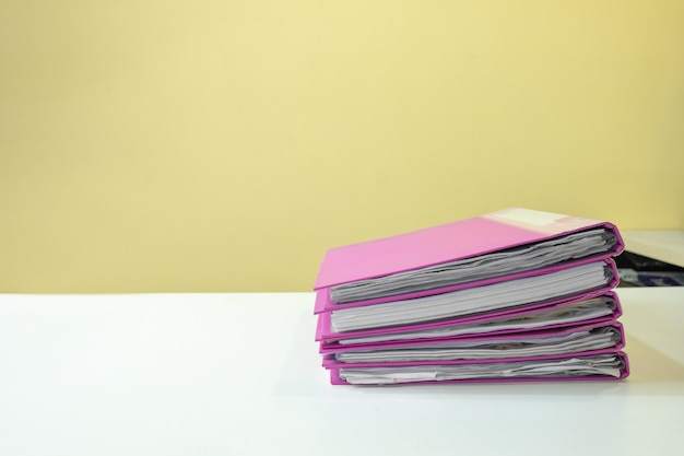 Stack of account file documents on white desk