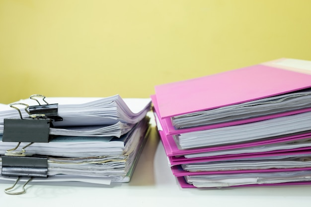 Stack of accounting documents on white desk