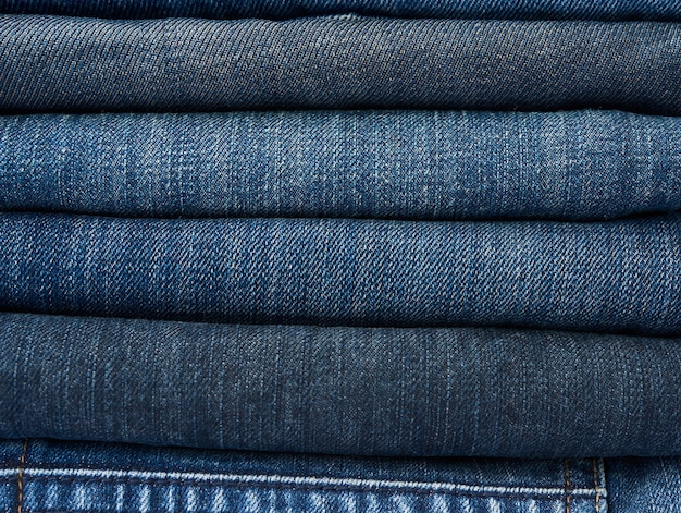 Stack of assorted pairs of jeans