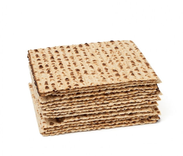 Stack of baked matzoh isolated on a white background