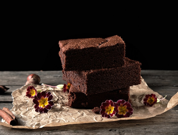 Stack of baked square pieces of chocolate brownie cake