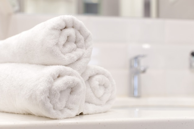 Stack of bath towels on light background