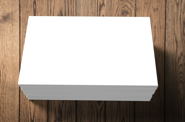Stack of blank name cards on wooden background