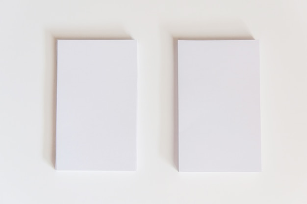 Stack of blank white business cards. mockup business cards on white background with clipping path