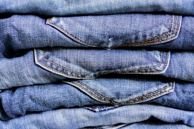 Stack of blue jeans texture. beauty and fashion clothing concept