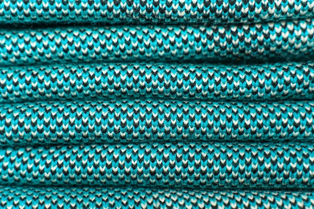 Stack of blue knitted fabric, knitted winter clothes.
