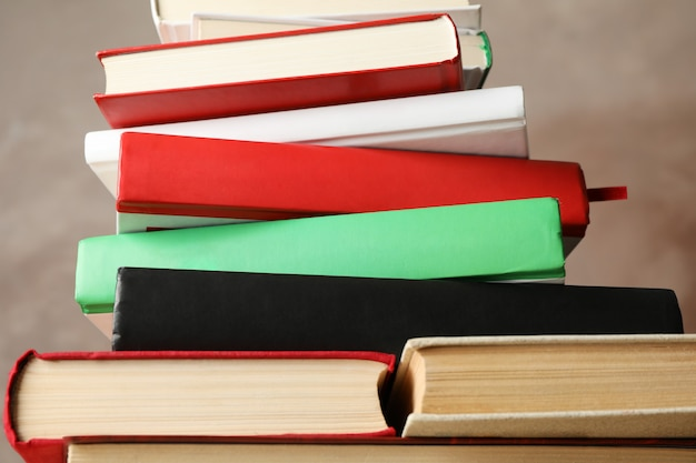 Stack of books against brown background, close up