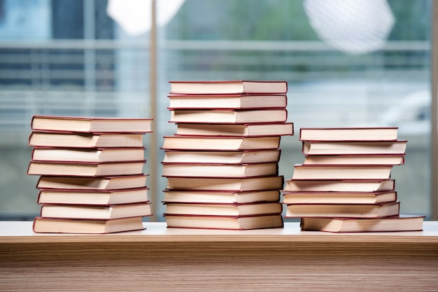 Stack of books arranged the office desk