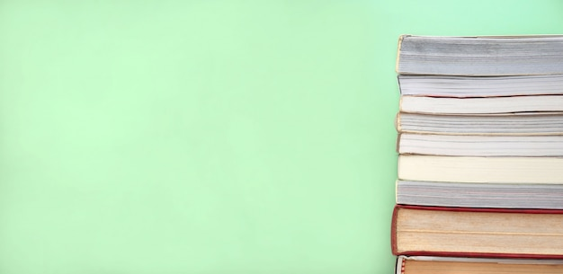 Stack of books green background with copy space. education and learning background.