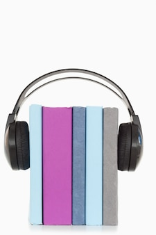 A stack of books and headphones