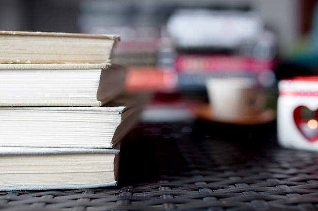 Stack of books on plastic tabletop