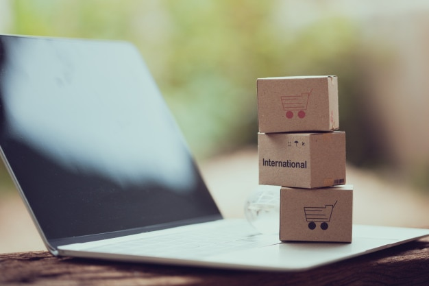 Stack boxes on laptop for customer can buy from electronic internet