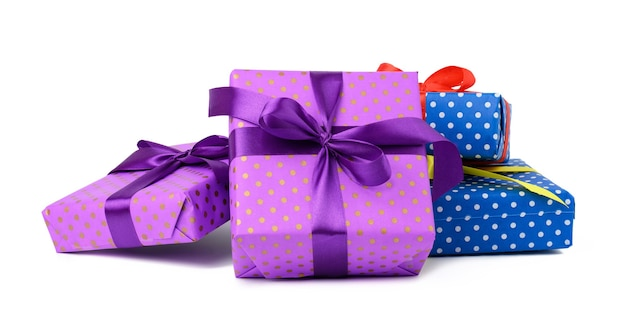 A stack of boxes wrapped in paper and tied with a silk ribbon on a white background, celebration. gift boxes set