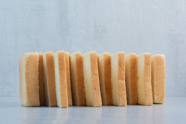 Stack of bread slices on blue background. high quality photo