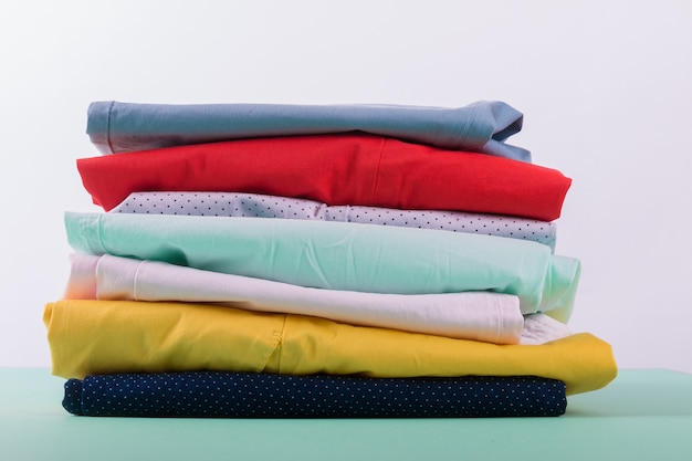 Stack of bright female trousers.