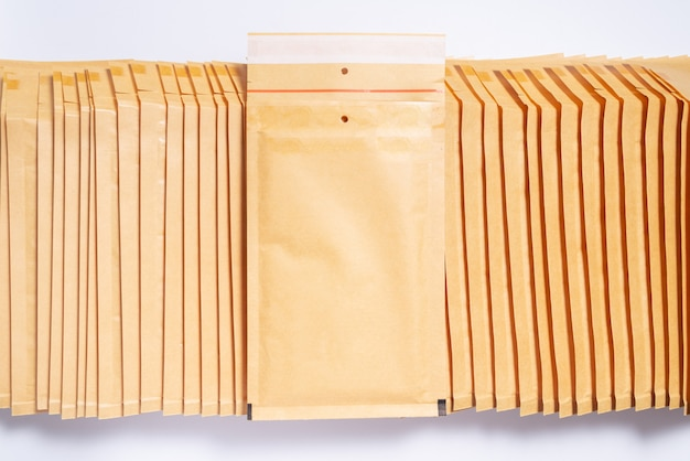 Stack of bubble envelopes, textured background