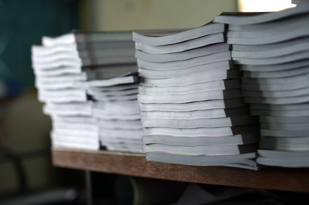Stack of business report paper files on desk