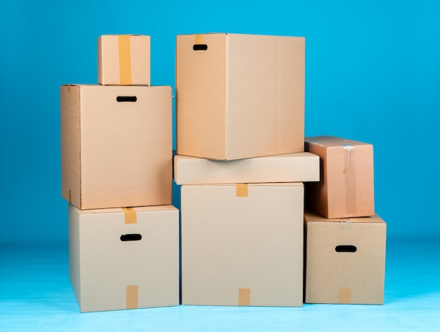 Stack of cardboard boxes on blue