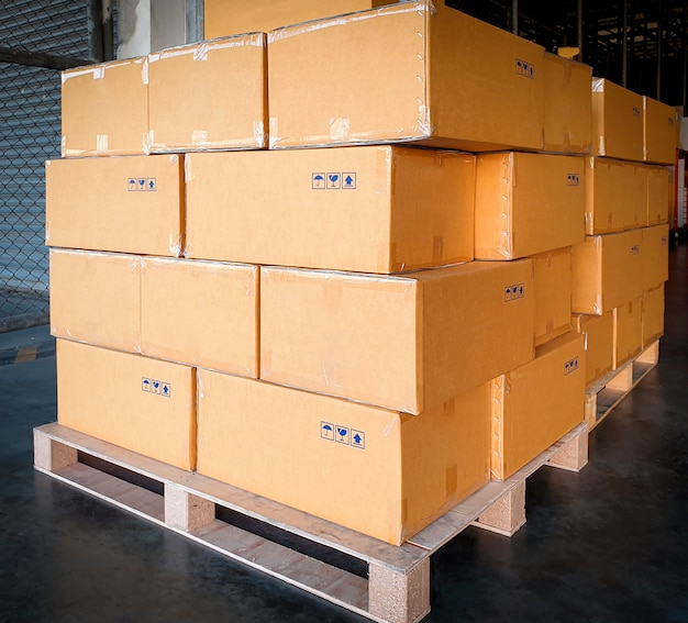 Stack of cardboard boxes on wooden pallet. cargo export, shipment, shipping warehouse.